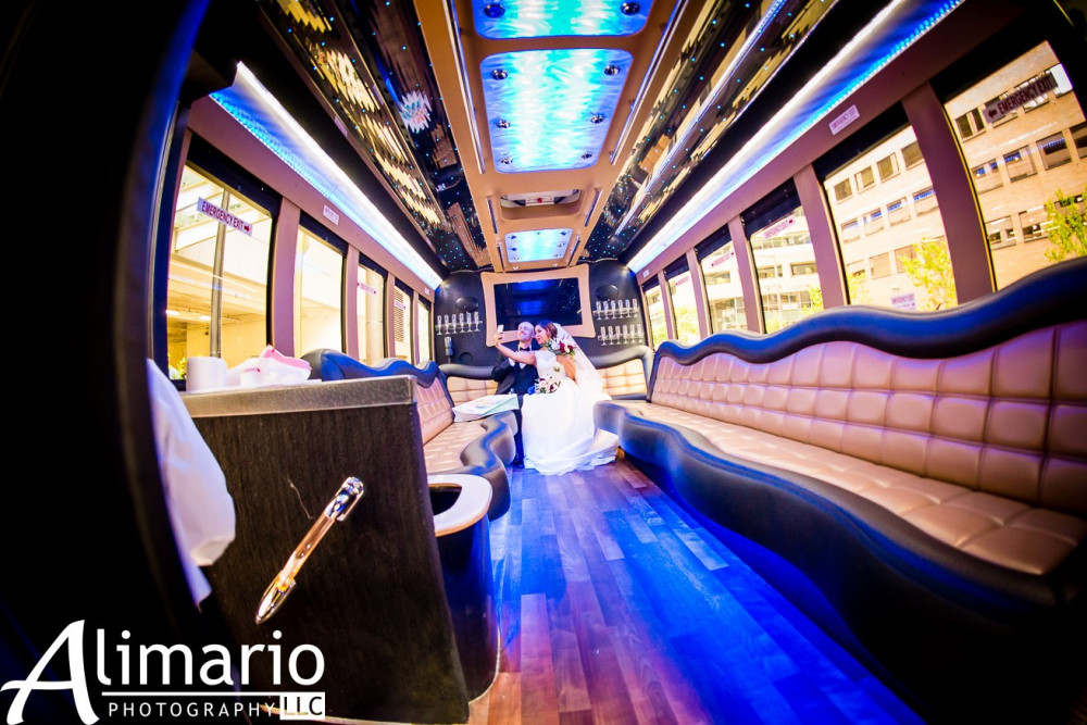 Wedding-Couple-in-Limousine-Bus
