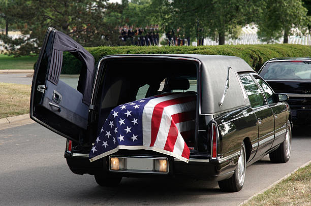Military funeral with coffin in hearse.