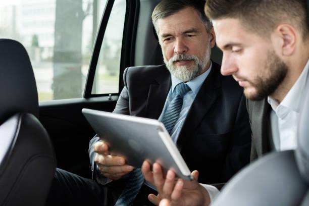 Lawyers Meeting Working Car Inside